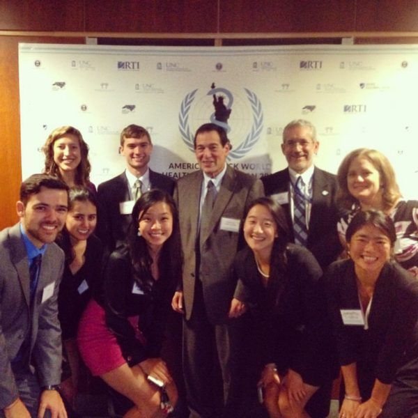 Yu (front, third from left) poses at the America's Mock World Health Organization (AMWHO) 2015 national conference with U.S. Ambassador Jimmy Kolker and AMWHO faculty adviser Jim Herrington.