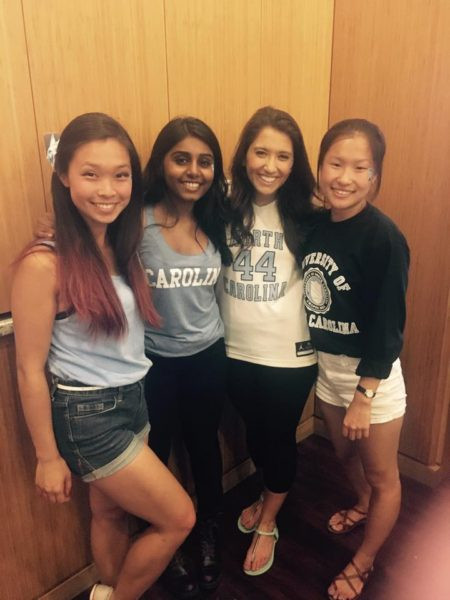 Bongu (second from left) and friends cheer on the Carolina basketball team at the Top of the Hill Restaurant watch party last year.