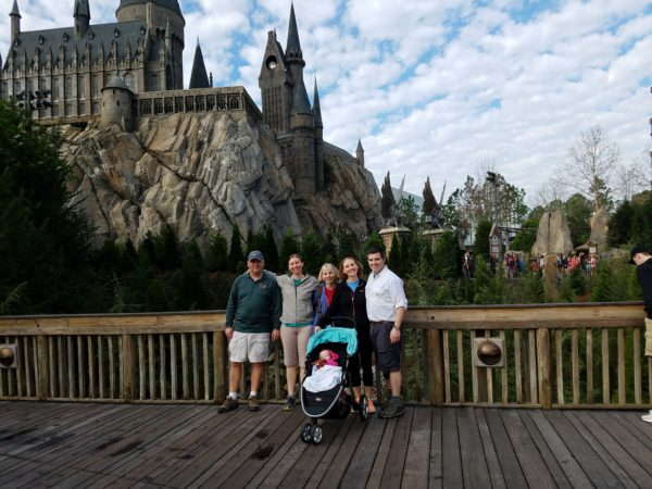 Fahey and her family poses in front of Hogwarts during their trip to the Wizarding World of Harry Potter at Universal Studios.
