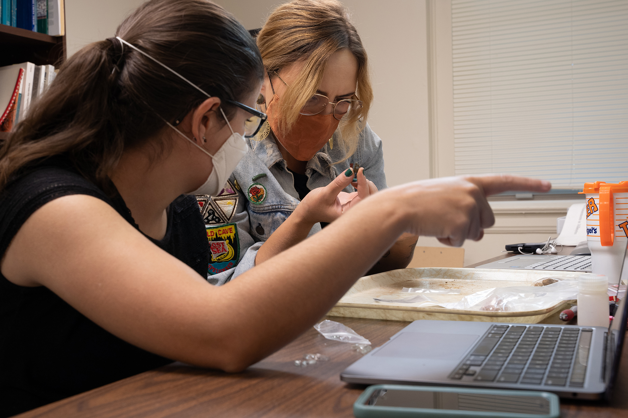 Colleen Betti and Cayla Colclasure analyze artifacts in a lab at UNC