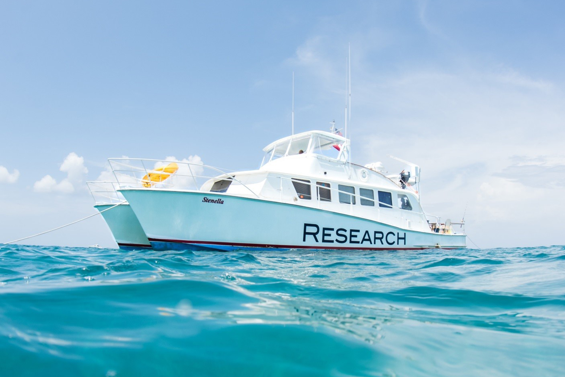 a research vessel called the RV Stenella sits in the middle of the Atlantic Ocean near the Bahamas