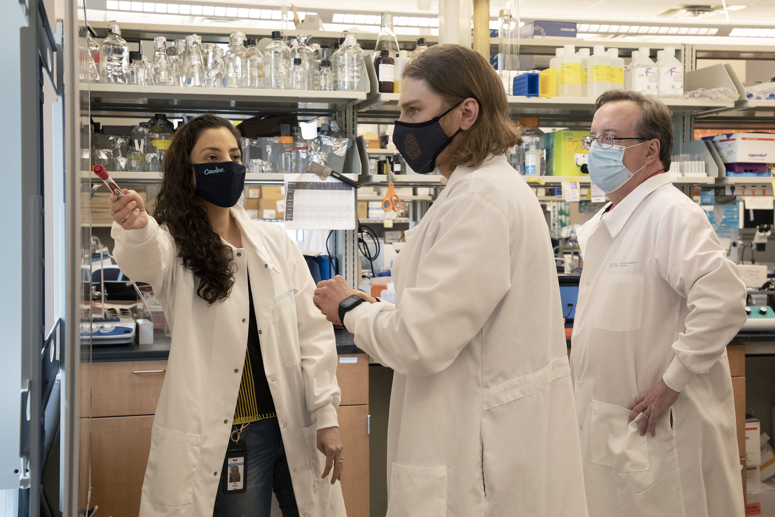 Isis Trujillo, Evan Paules, and Walter Friday in the lab