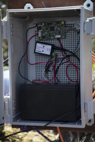 inside of a co2 monitoring station, full of wires and a circuit board