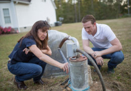 Jacqueline MacDonald Gibson and Frank Stillo test the well water at a home just outside city limits in Wake County.