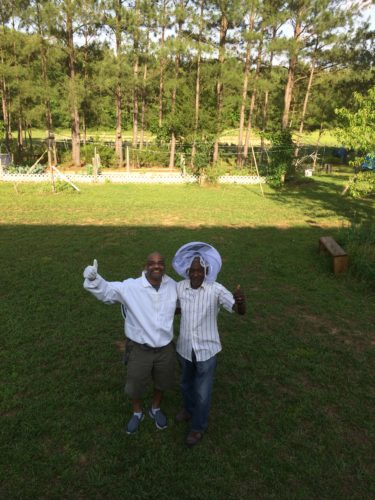 Terry and his cousin, George Bullock, after a successful day of tending to bees.