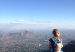 Hauser overlooks Malawi, Africa's beautiful landscape from atop a mountain