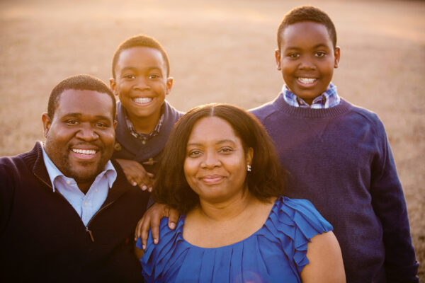 Kimberly Burnett, her husband Otis, and her two sons Braxton and Bryce