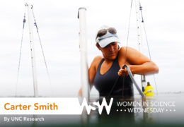 a female marine science researcher in the water