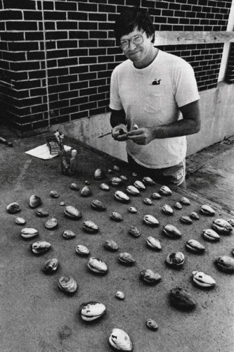 Peterson paints clams for later identification in the laboratory