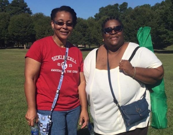 Jenerette (left) stands alongside colleague and collaborator Diana Wells, the clinical social worker for the UNC Comprehensive Sickle Cell Program, at a sickle cell awareness event.