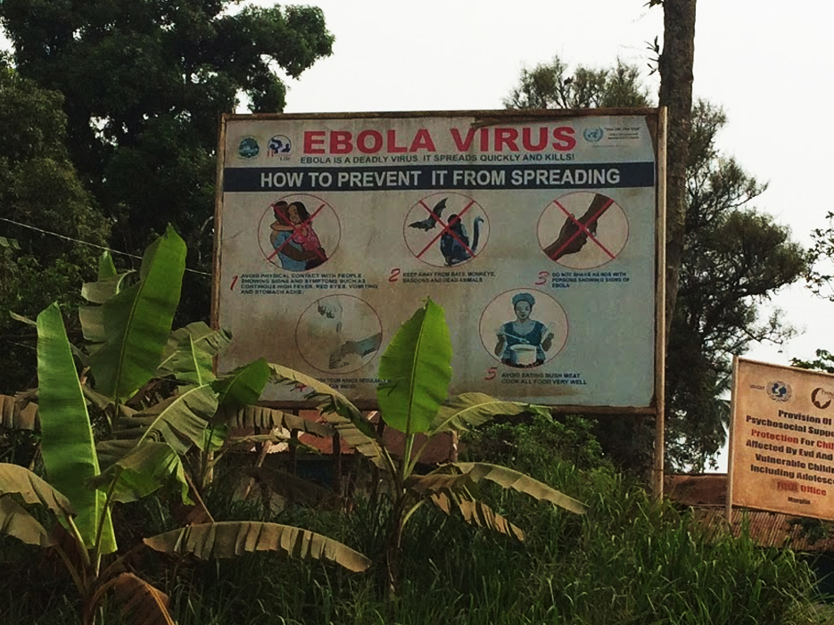 "Sign sits out in a country side that says ""Ebola Virus, How to Prevent it From Spreading"""