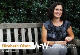 Elizabeth Olson poses on a bench on campus.