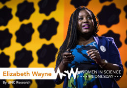 an African-American woman presents on stage at a TED Talk in Texas