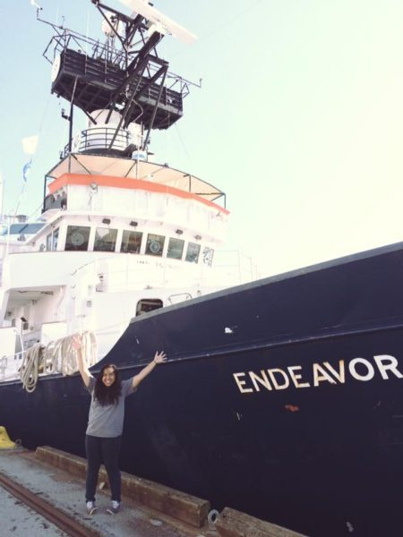 Abella poses in front of the R/V Endeavor in the North Atlantic