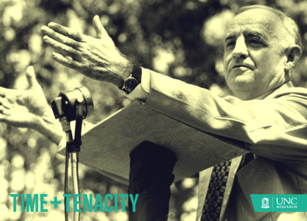 an older man gives a speech at a podium