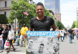 "Felton Thomas holds up a sign that reads ""Prevention 4 me"" at an event that supports the LGBT Center in Raleigh"