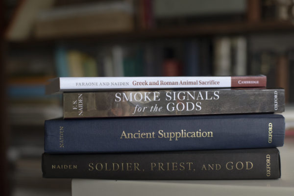 "Four of Fred Naiden's books, which include ""Greek and Roman Animal Sacrifice,"" ""Smoke Signals for the Gods,"" ""Ancient Supplication,"" and ""Soldier, Priest, and God"""