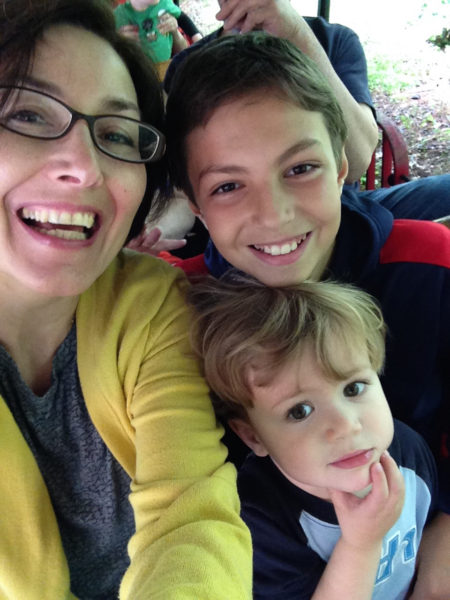 Gökarıksel and her two sons ride the train at the Museum of Life and Science in Durham.