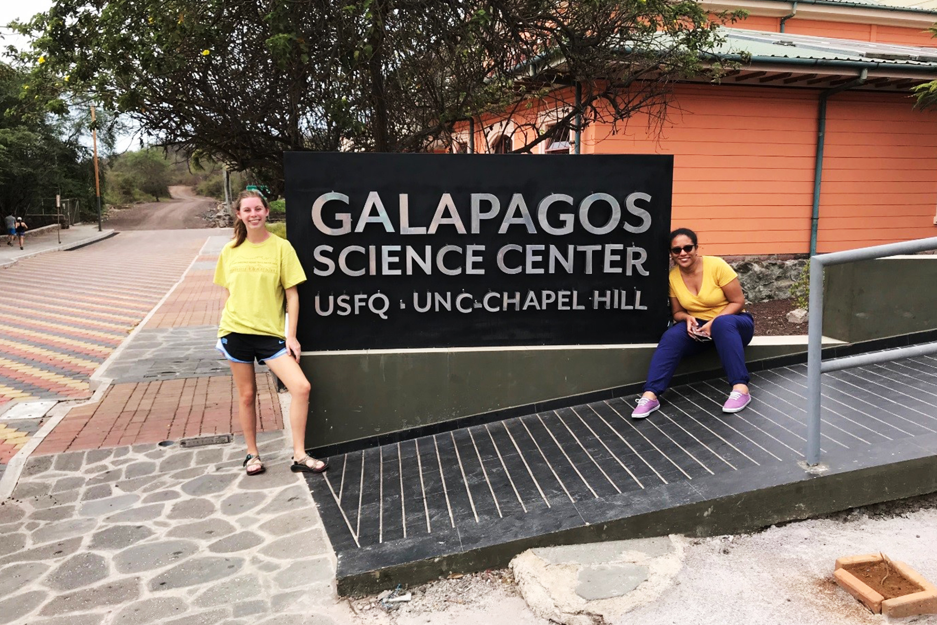 Haley Moser and Angelica Gomez pose in front of the Galapaogs Science Center