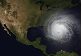 A bird's eye view of the United States, with a hurricane moving over the Caribbean toward the eastern U.S.