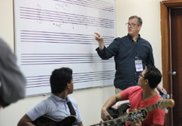 Music professor Stephen Anderson explains some of the theory behind improvisation in jazz composition during a master class at the National Conservatory of Music in Santo Domingo.