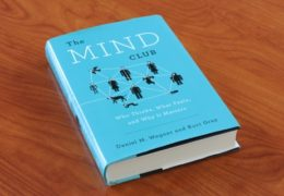 "Picture of ""The Mind Club"" book on a table."