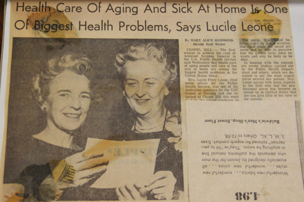 "Newspaper clipping titled ""Health Care of Aging and Sick At Home Is One of Biggest Health Problems, Says Lucile Leone"" Image in the article depicted Dean Kemble with another female, smiling."