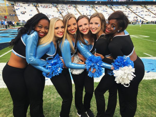 Currence poses with her teammates fro the UNC dance team