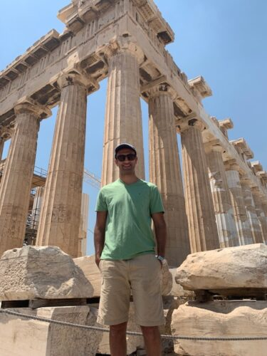 Saif Kairat stands in front of the Acropolis in Athens, Greece