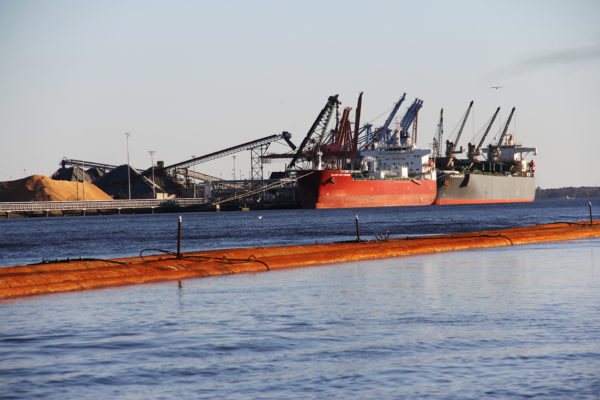 cranes load freighters with shipping containers at the Port of Wilmington