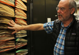Alan Weakley shows off the storage system at the UNC Herbarium. Founded in 1908 by William Chambers Coker, it resides on the top floor of Coker Hall and is the largest in the Southeast. In 2000, it became part of the North Carolina Botanical Garden. Specimens are kept within folders inside large, green cabinets that litter the various floors of the building.