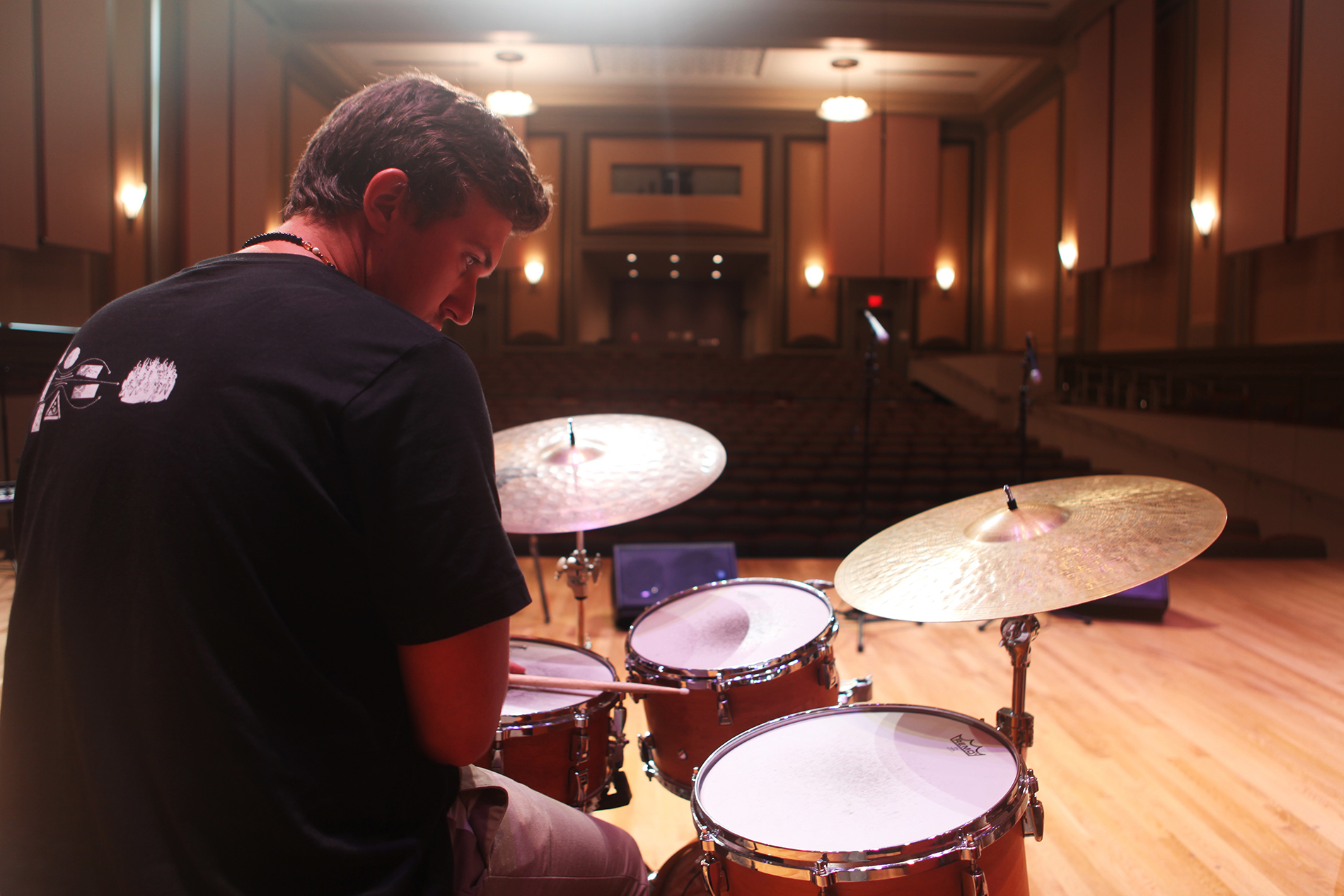 a young man plays the drums