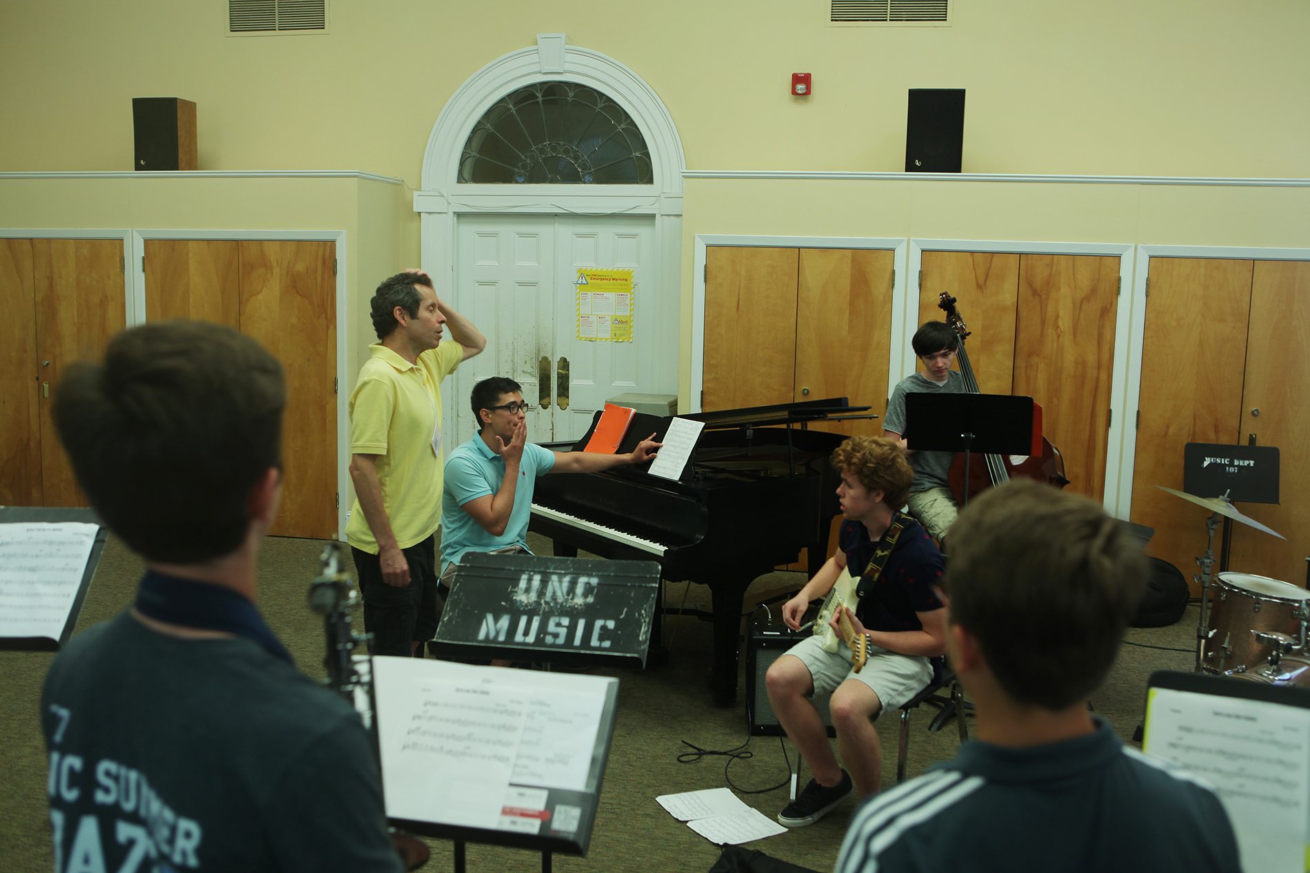 a group of students tune their instruments