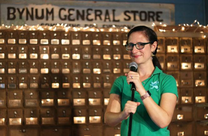 Sarah Beth Nelson braces a microphone