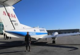 UNC hydrologist Tamlin Pavelsky stands in front of a NASA KingAir B200, which houses the AirSWOT suite of instruments. Scientists including Pavelsky are using AirSWOT to provide new measurements of surface water and ocean topography, which help them understand the movement of water around the planet. AirSWOT flights are being conducted in preparation for the SWOT satellite mission, which will launch in 2021 and make similar measurements for the whole globe.
