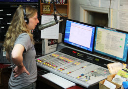Jaycie Vos talks into a microphone at a radio station.
