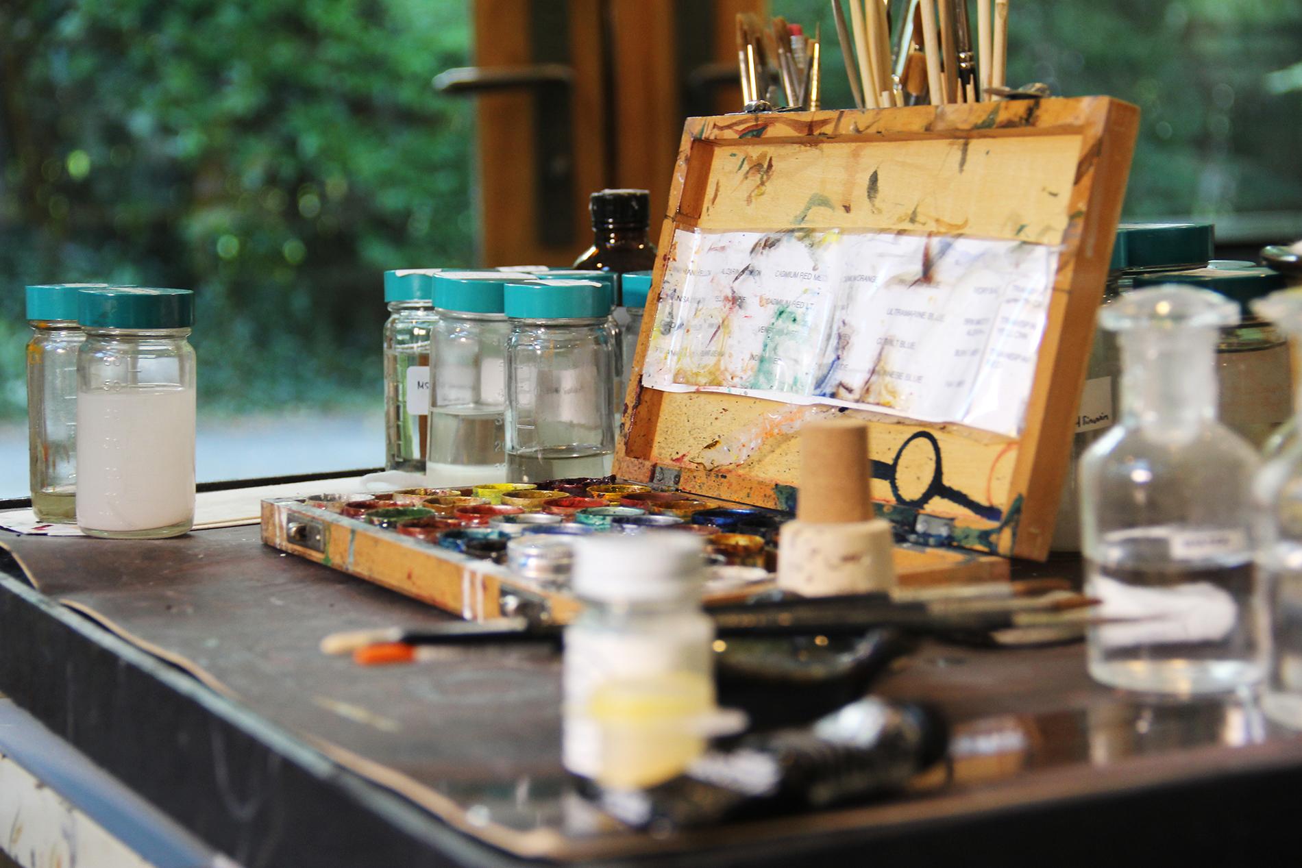 a painter's palette sits on a cart