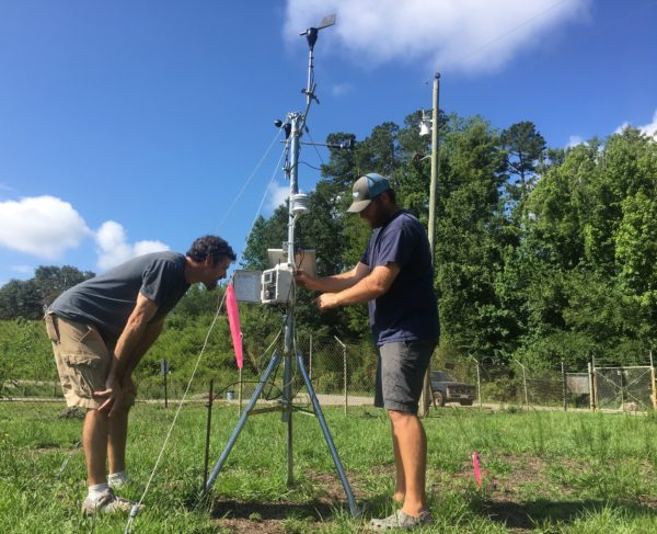 Nathan Hall and Jeremy Braddy set up a weather station