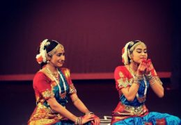Deva and sister Meera perform a classical indian dance in traditional Indian garb
