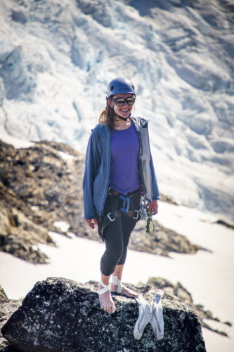 Cary Onnink stands in front of battle glacier without her shoes on.