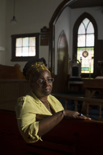 Jereann King Johnson sits in the sanctuary of Oak Chapel AME Church in Warrenton. The church was one of the only local institutions that fought for the release of Matthew Bullock's brother and cousin prior to their death.