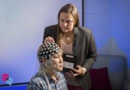 Julianna Prim places nodes on a patient's head