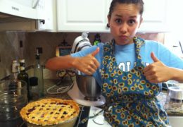 Tsai proudly displays a blueberry pie with two thumbs up