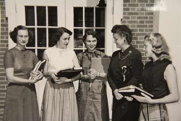 Dean Kemble (second from right) chats with students from the class of 1955.