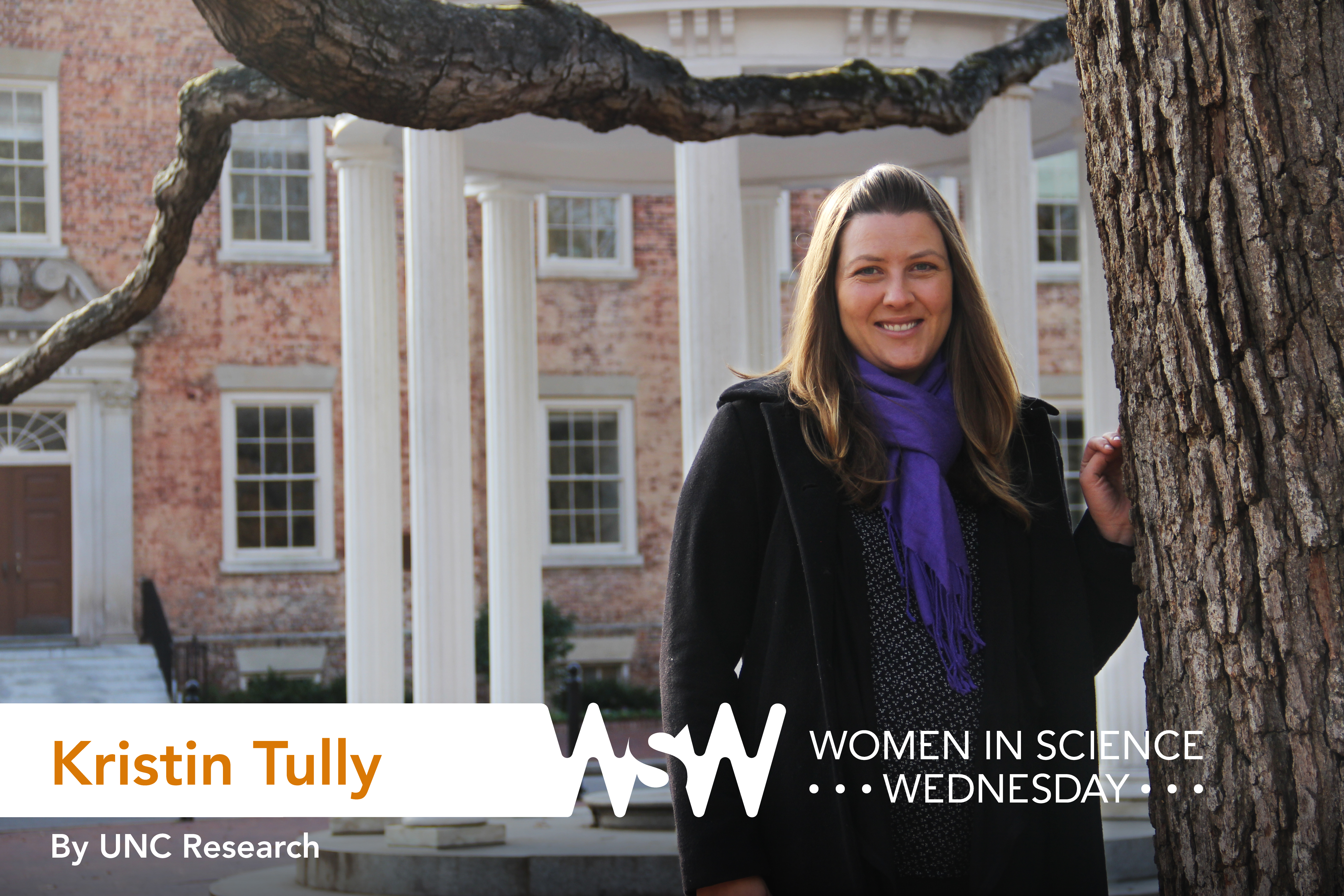 Kristin Tully poses on campus in front of the Old Well