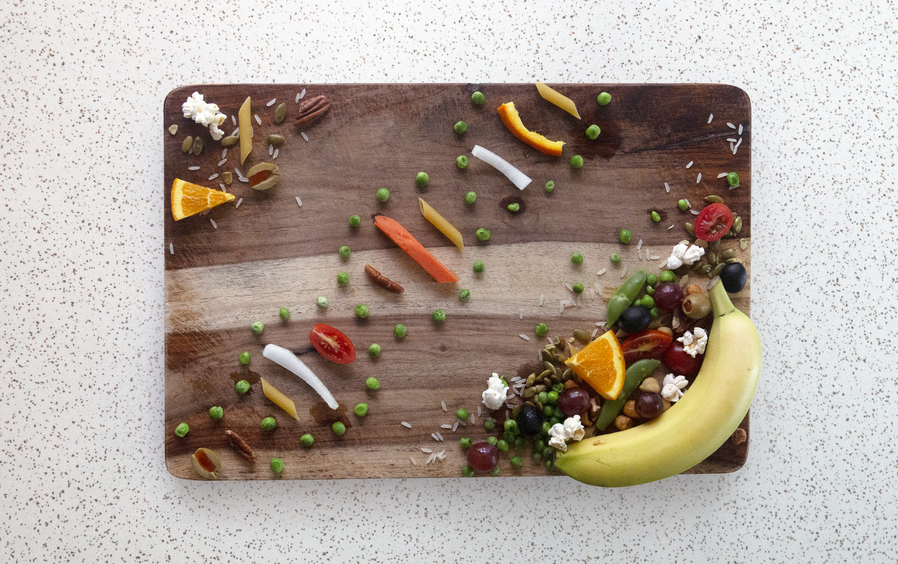 a cutting board with a DNA strand made out of food