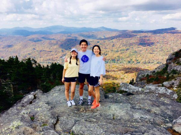 Ling (left) hikes with friends at Grandfather Mountain during fall break.