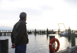 Glenn Safrit watches the sunset over the R/V Capricorn, a boat on which he has spent many work days assisting UNC students, research technicians, and faculty members with their marine research.