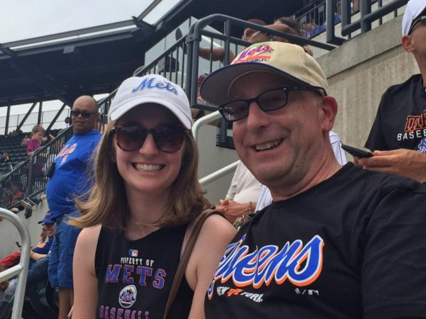 Bond poses with her dad at a Mets game