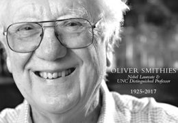 "Black and white photo of Oliver Smithies with a great big smile that reads ""Oliver Smithies: Nobel Laureate and UNC Distinguished Professor. 1925 to 2017"""